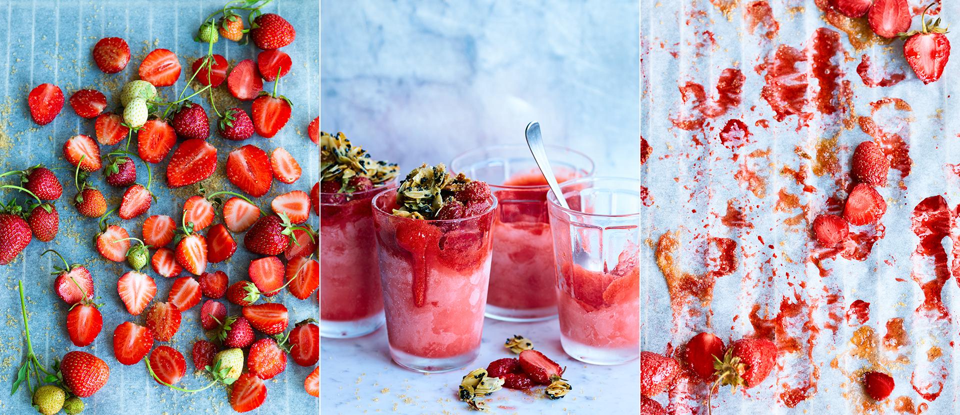 Blech mit Backpapier und ganzen und halbierten Erdbeeren. angefrorene Glaeser mit Erdbeersorbet, gebackenen Erdbeeren und Granola aus Mandelblaettchen und Schwarzkuemmel. Backblech mit Backpapier und gebackenen Erdbeeren