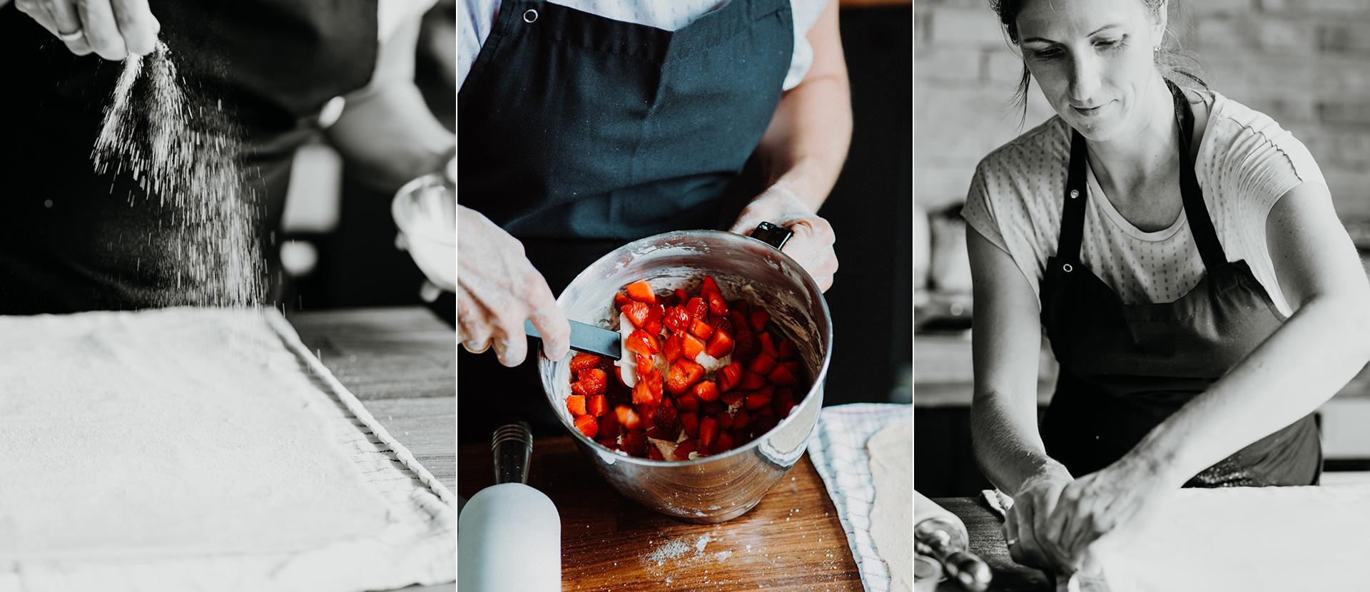 Mehl wird mit den Haenden auf Strudelteig gegeben. Frau ruehrt in einer Schuessel mit Erdbeeren. Frau zieht Strudelteig - Foodstyling Muenchen