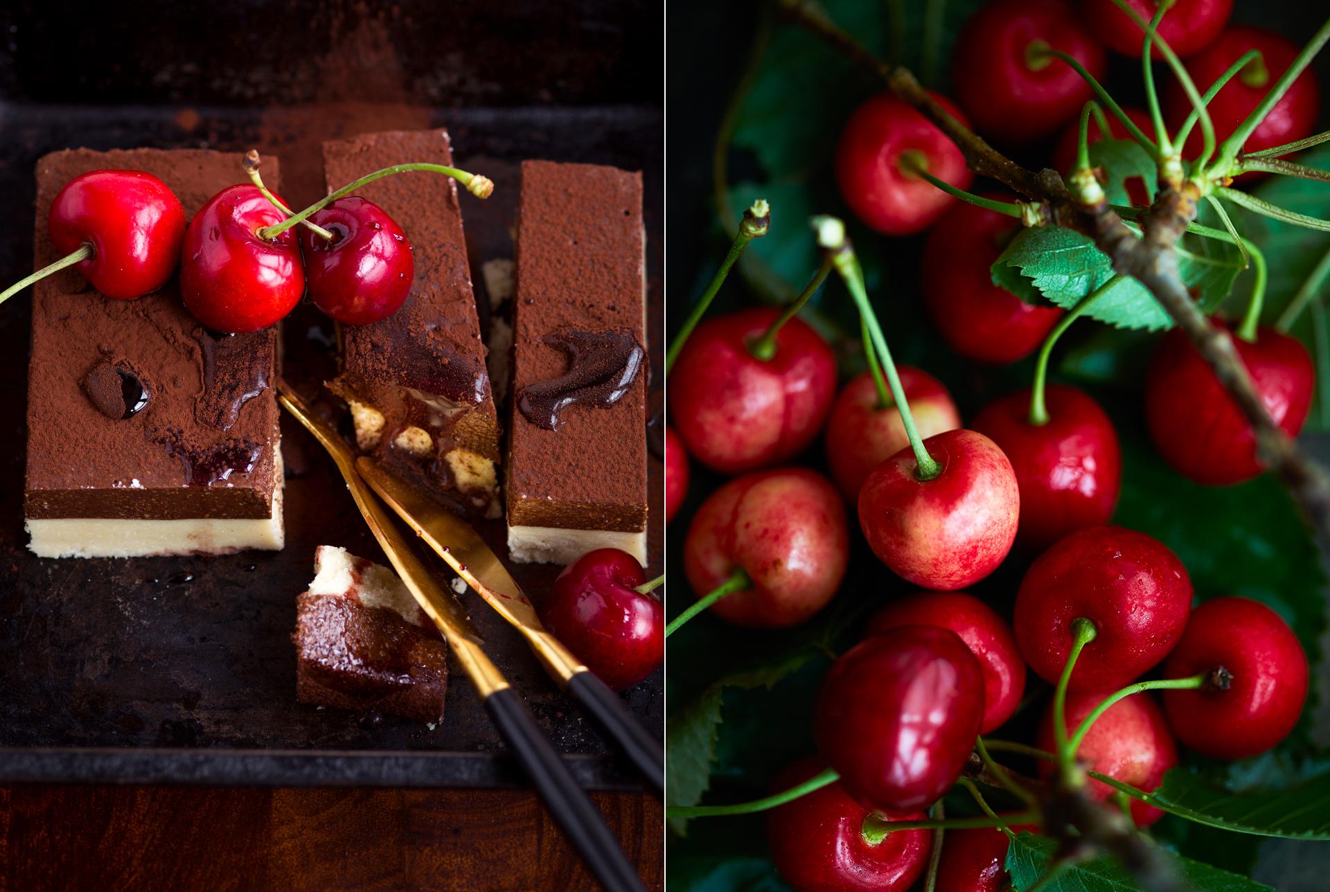 Nougatschichtspeise aus hellem und dunklem Nougat mit Kakaopulver und Kirschen verziert. Nahaufnahme eines Kirschzweiges