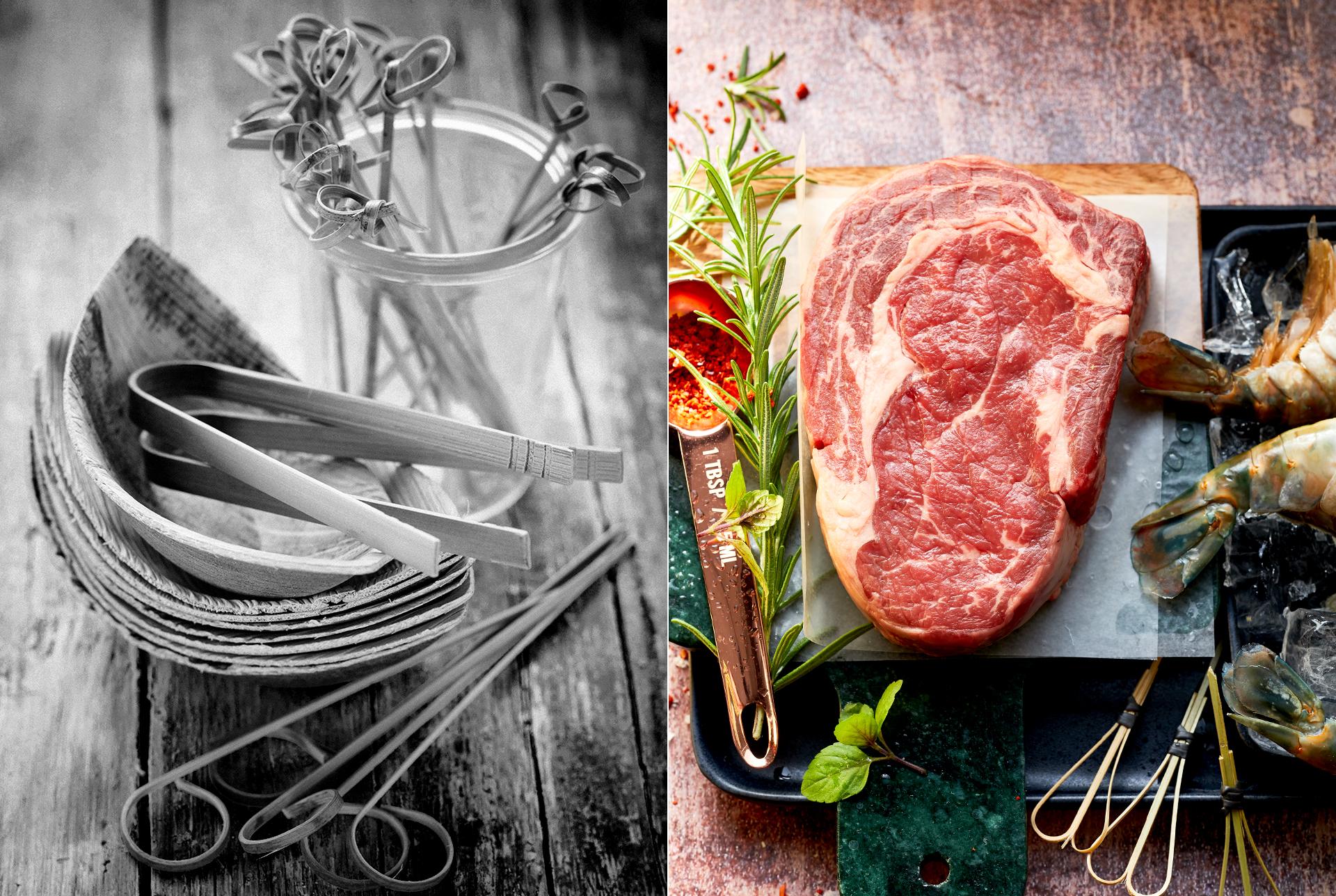 rohes Steak mit rohen Garnelen, Rosmarin und Chiliflocken. gestapeltes Einweggeschirr mit Holzspiessen fotografiert von Katrin Winner