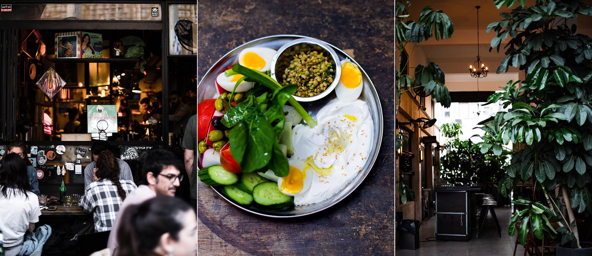 Terrasse mit Personen beim Essen in einem Lokal in TelAviv. Teller mit Joghurt, Olivenoel, wachsweiches Ei, Gurken,  Tomaten, Oliven und Salat.