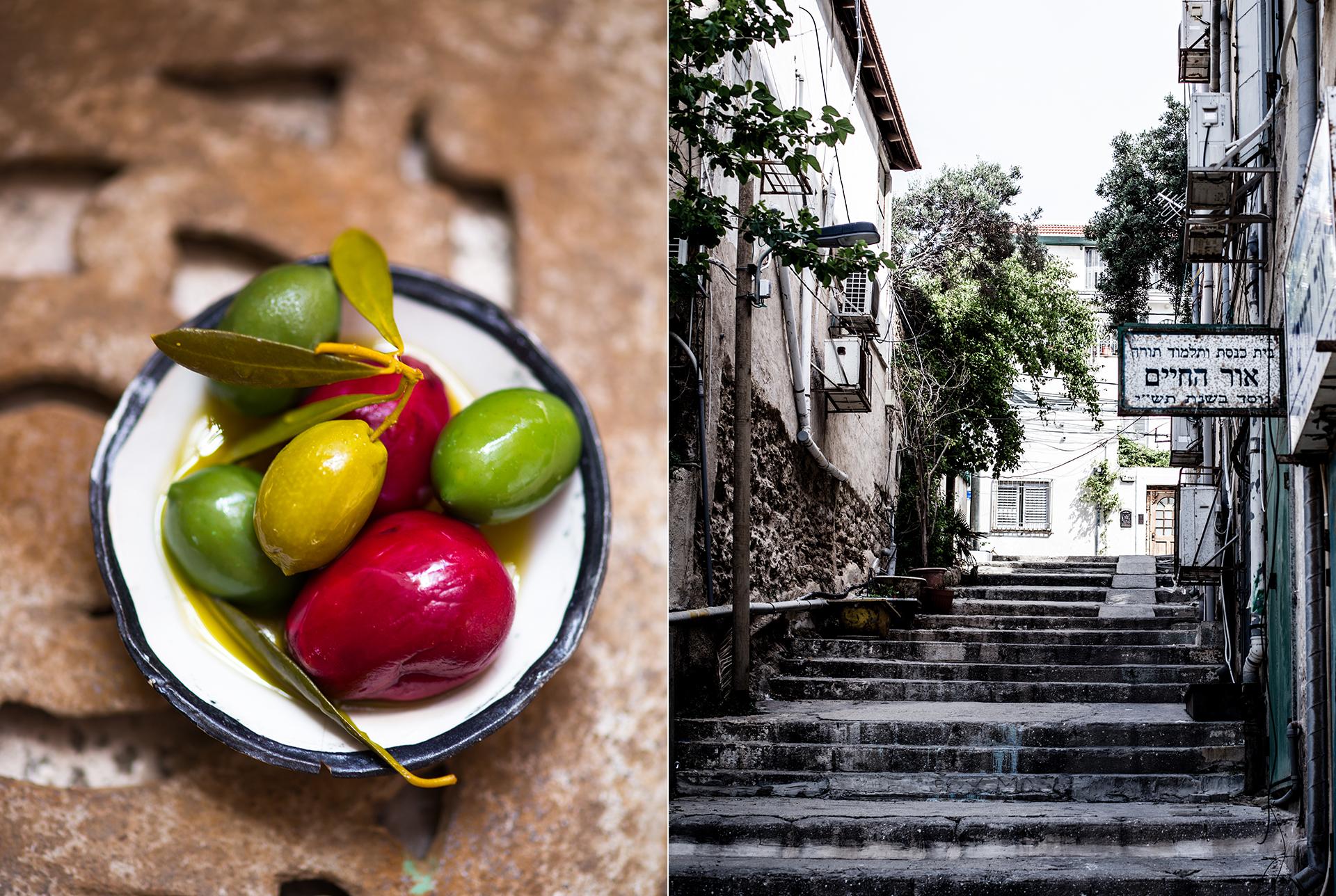 Schale mit Oliven und eingelegtes Gemuese. Steintreppe in TelAviv